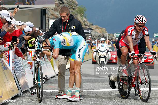 Lieuwe Westra of The Netherlands and Team Astana is exhausted at the finish line after winning the seventh stage of the Criterium du Dauphine on June...