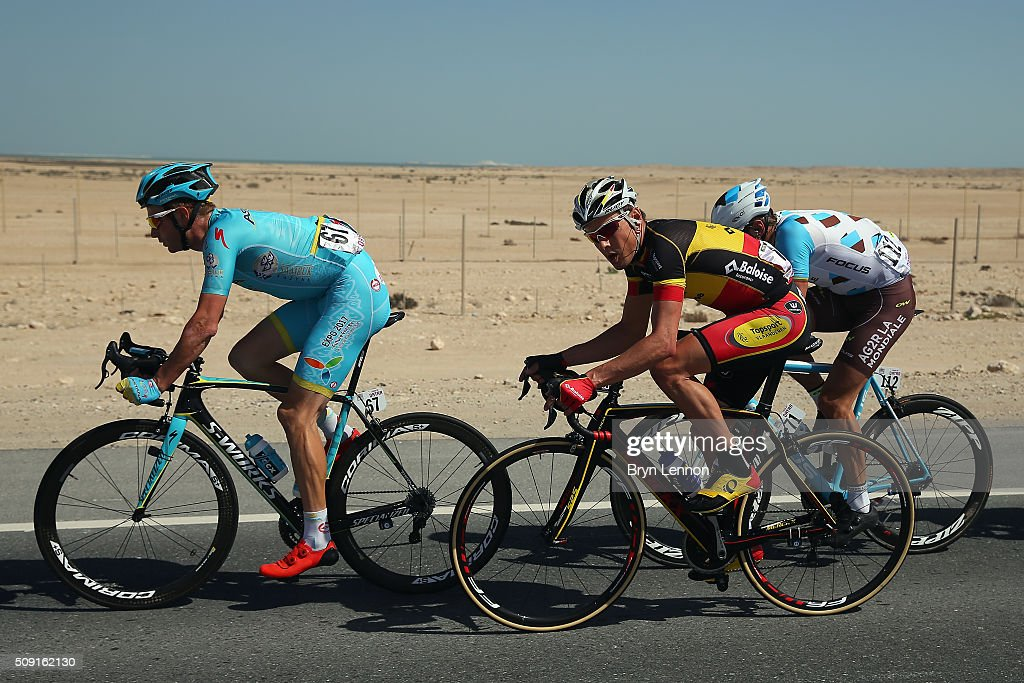 Lieuwe Westra of The Netherlands and the Astana Pro Team leads Preben Van Hecke of Belgium and Topsport Vlaarenderen-Baloise and Gediminas Bagondas of Lithuania and AG2R in the breakaway group during stage two of the 2016 Tour of Qatar from Qatar University to Qatar Univeristy on February 9, 2016 in Doha, Qatar. The stage also serves as a test event for the World Road Race Championships which will be held in Doha in October.