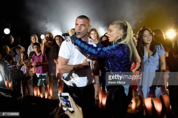 Liev Schreiber and Fergie sing onstage at the weekend opening of The NEW ultraluxury Cove Resort at Atlantis Paradise Island on November 4 2017 in...