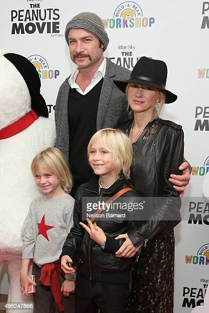 Liev Schreiber Naomi Watts Samuel Kai Schreiber and Alexander Pete Schreiber attend the Peanuts movie and BuildABear Workshop special screening at...