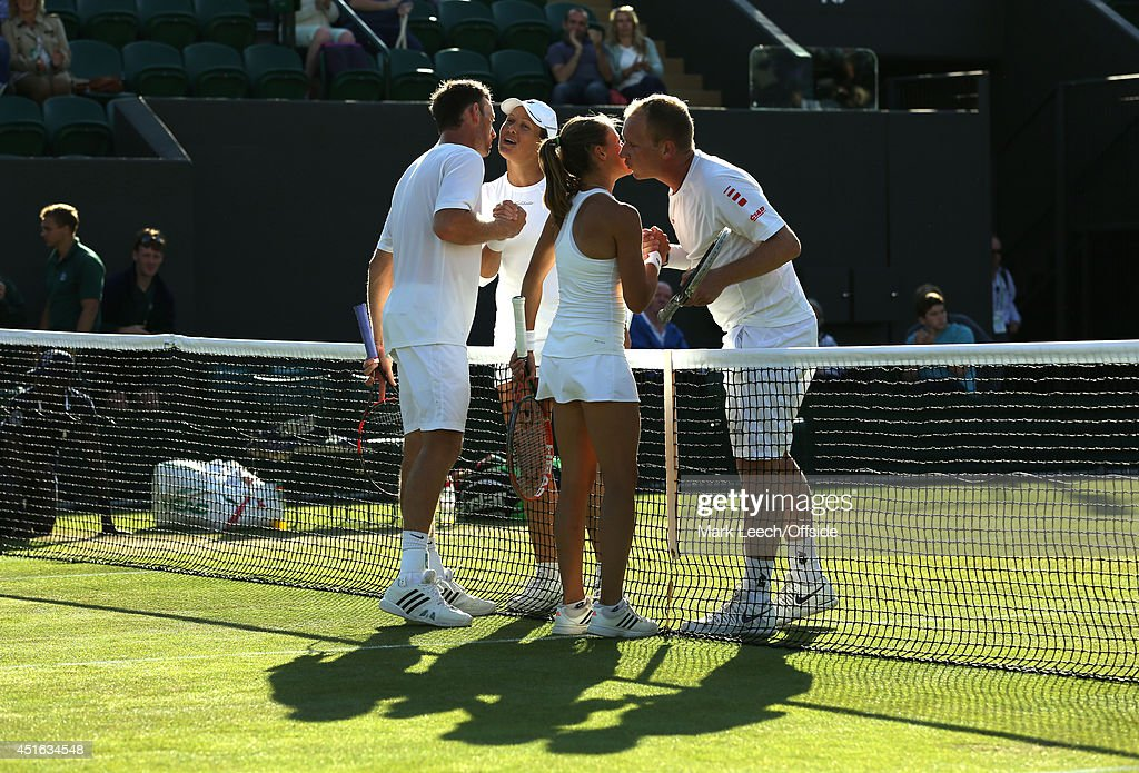 Liezel Huber and Lukas Dlouhy shake hands with Michael Venus and Alicja Rosolska at the end of the Mixed Doubles First Round match on day 5 of the...