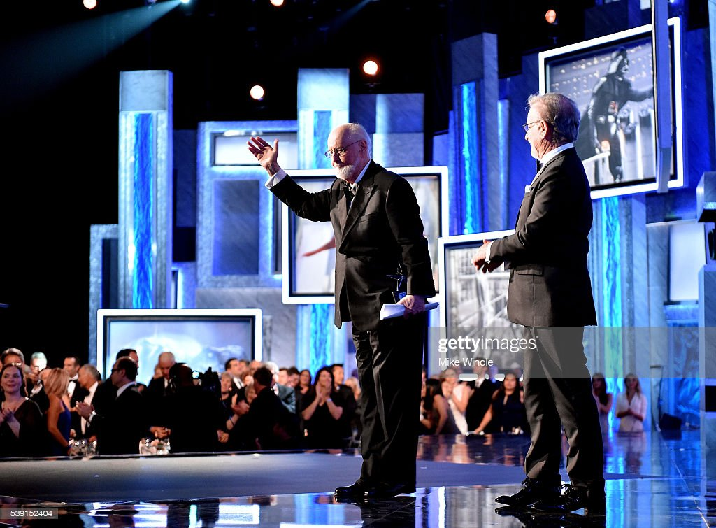 AFI Life Achievement Award recepient John Williams (L) and director Steven Spielberg onstage during American Film Institute's 44th Life Achievement Award Gala Tribute show to John Williams at Dolby Theatre on June 9, 2016 in Hollywood, California. 26148_002