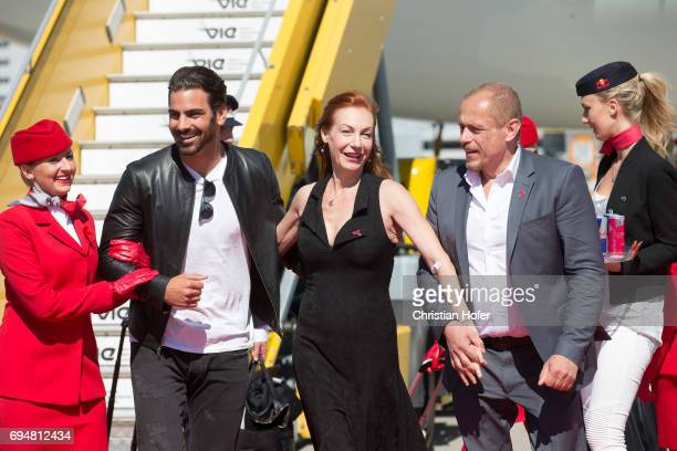 Life Ball organizer Gery Keszler Ute Lemper and Nyle DiMarco arrive on the Life Ball plane on June 9 2017 in Vienna Austria The Life Ball an annual...