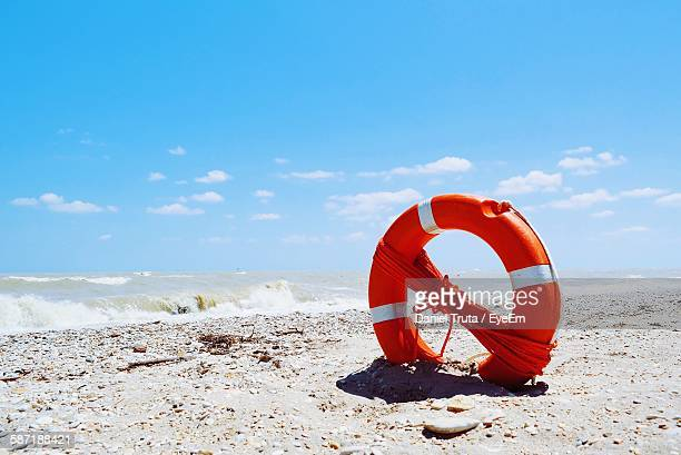 Life Belt With Rope On Sandy Beach