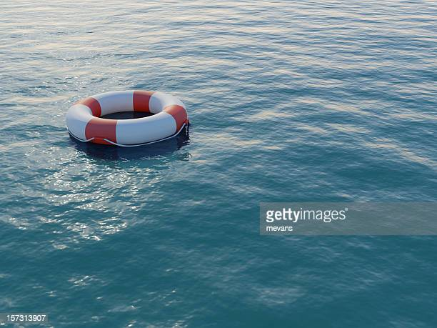 Life buoy floating on a rippled sea