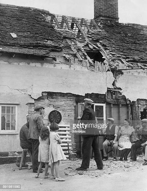 Life carries on as usual at a country pub in England Locals enjoying a pint of beer and a game of darts at a bomb damaged pub following an air raid...