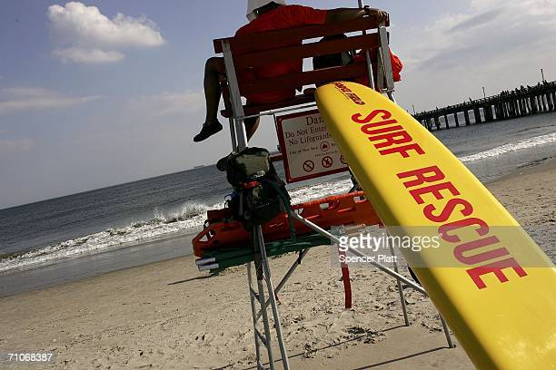 A life guard keeps watch on the water on the opening day of New York City beaches May 27 2006 in Coney Island New York With blue skies and warm...