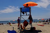 A life guard sits on a bench at Rockaway Beach on July 26 2016 in New York City Temperatures are expected to stay in the 90's across most of the...