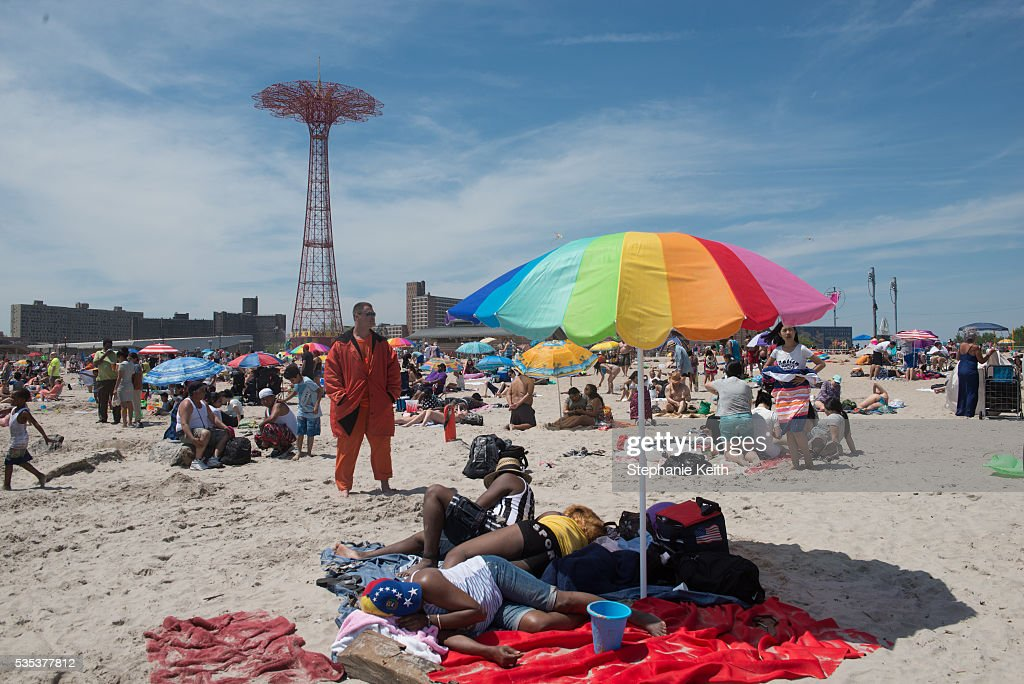 A life guard stands watch during a day at the beach in Coney Island on May 29, 2016 in the Brooklyn borough of New York City. New York City is experiencing higher than average temperatures for the holiday weekend.