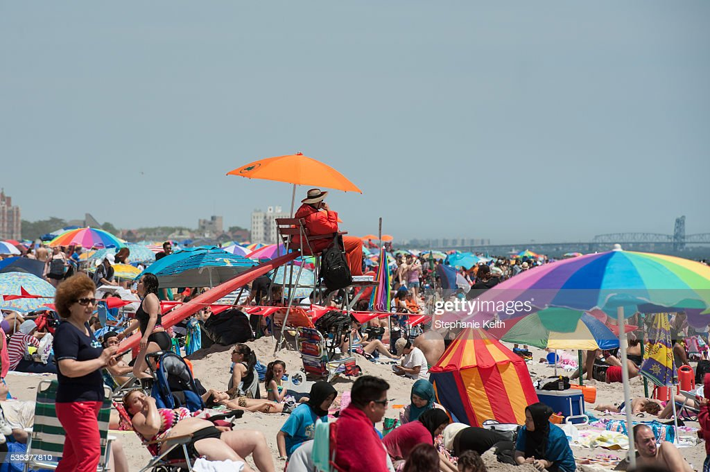A life guard watches beach goers in Coney Island on May 29, 2016 in the Brooklyn borough of New York City. New York City is experiencing higher than average temperatures for the holiday weekend.