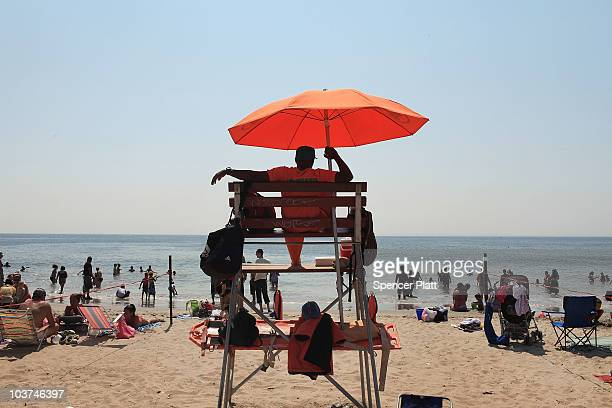 A life guard watches swimmers on a hot afternoon at Coney Island on August 31 2010 in the Brooklyn borough of New York City While much of the east...