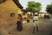 Life in a village such as this commonplace in India was lived in a very simple elemental and subsistance style This is a street scene in a small...