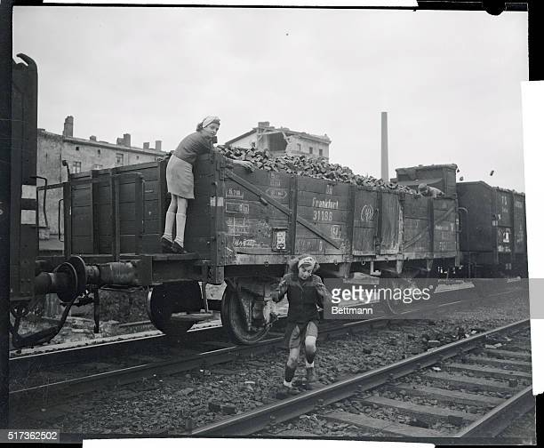 Life In Berlin Two Berlin schoolgirls are shown as they were caught in the act of raiding a coal train from the Ruhr Youngsters steal goal either for...