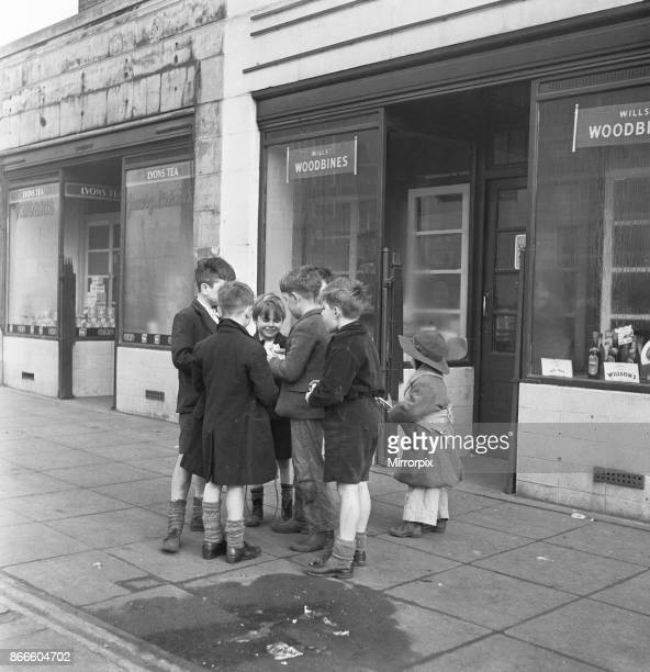 Life in the Mirror Our Gang 19th January 1954 A gang of boys plot todays agenda of mischief and mayhem outside a tobacconist in Bow Road in the East...