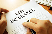 Life insurance policy on a table.