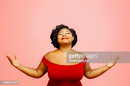 Life is wonderful/ Portrait of a confident and  satisfied woman with both hands out : Foto de stock