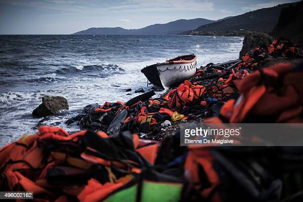 Life jackets and a lifeboat used by refugees liter the north coast of Lesbos on November 1 2015 near Skala Sikaminias Greece Lesbos the Greek...