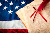 The American flag, the US constitution and a fountain pen, can be used for 4th of july or any other patriotic holiday. Land of the free and home of the brave.