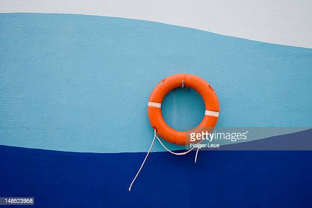 Life ring on wall of cruiseship pier.