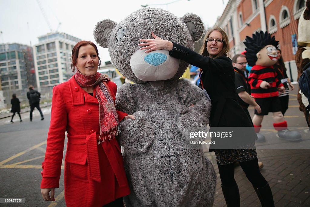 Life size cartoon characters are led outside for a photocall during the 2013 London Toy Fair at Olympia Exhibition Centre on January 22, 2013 in London, England. The annual fair which is organised by the British Toy and Hobby Association, brings together toy manufacturers and retailers from around the world.