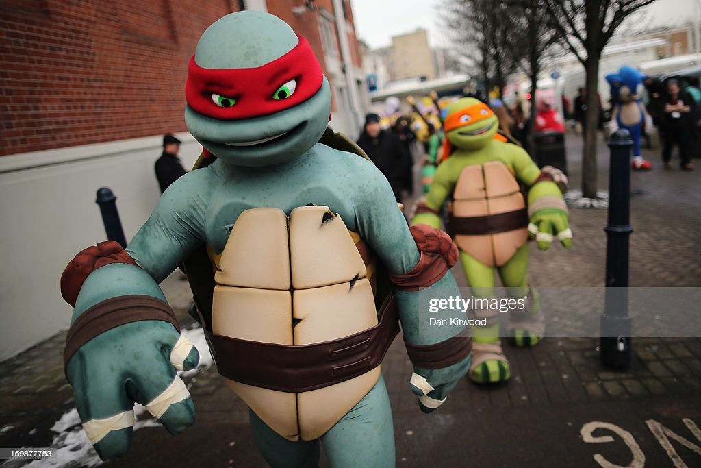 Life size Teenage Mutant Ninja Turtles cartoon characters are led outside for a photocall during the 2013 London Toy Fair at Olympia Exhibition Centre on January 22, 2013 in London, England. The annual fair which is organised by the British Toy and Hobby Association, brings together toy manufacturers and retailers from around the world.