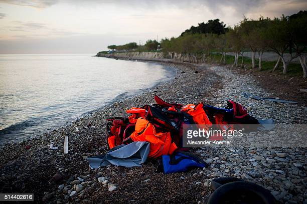 Life vests are seen after an inflatable boat with refugees arrived crossing the sea from Turkey to Lesbos some 5 kilometres south of the capital of...