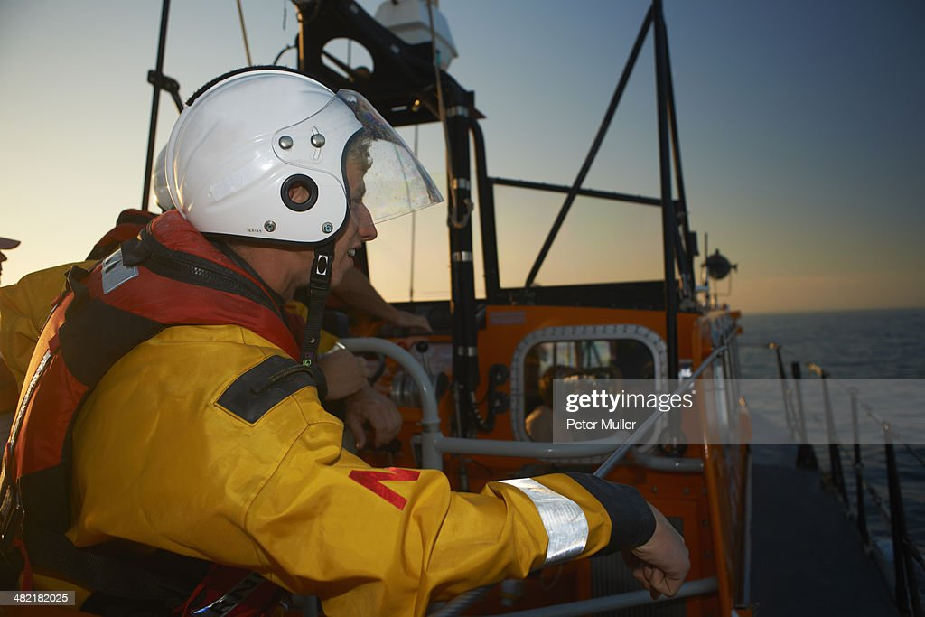 Lifeboat crew training on lifeboat at sea