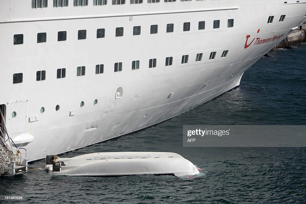 A lifeboat remains in the sea after falling from a cruise liner Thomson Majesty called 'Valletta' and killing 5 people during a safety drill while it was docked at La Palma in the Canary Islands on February 10, 2013. The accident at the port of Santa Cruz on La Palma, the most northwesterly of the Canaries, also left three people injured.