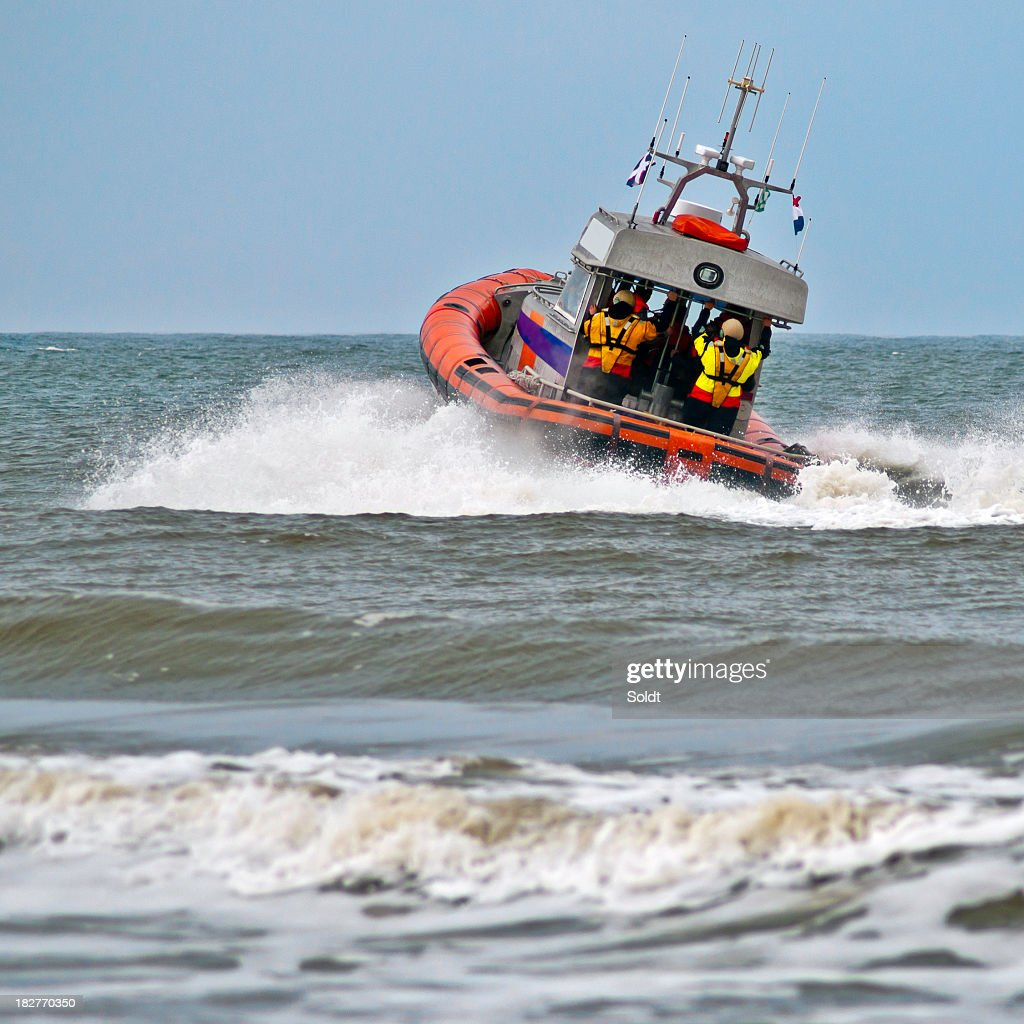 A lifeboat rides a wave as it sets off into action