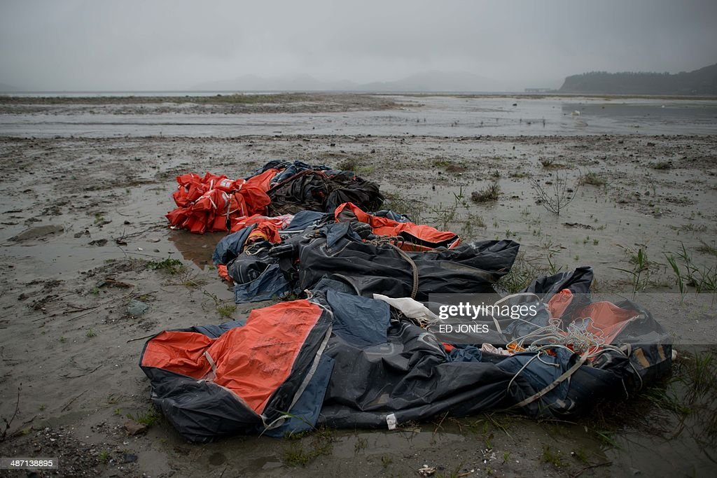 Lifeboats and life jackets recovered from the sea surrounding the 'Sewol' ferry are left at the shore near Jindo harbour where relatives of the...