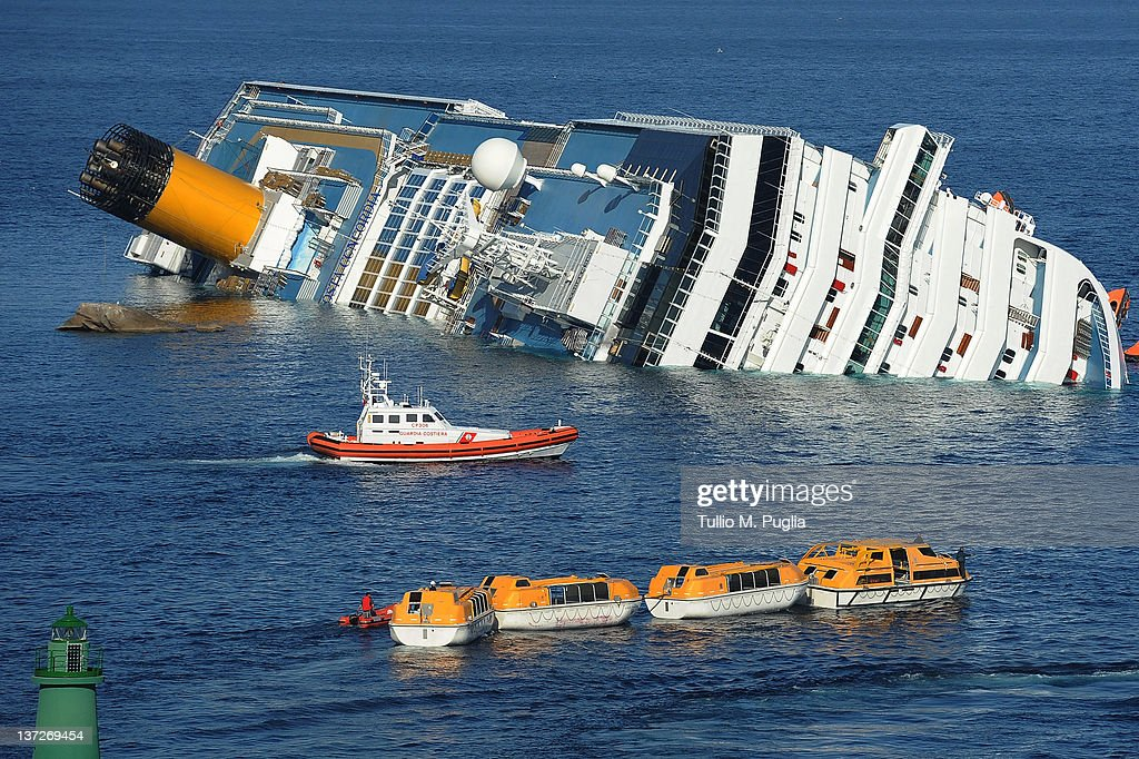 Lifeboats of cruise ship Costa Concordia are towed away on January 18, 2012 in Giglio Porto, Italy. The official death toll is now 11, with a further 24 people still missing. The rescue operation was temporarily suspended earlier due to the ship moving as it slowly sinks further into the sea.