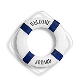 White color life buoyancy with welcome aboard on it hanging on white concrete wall with clipping path