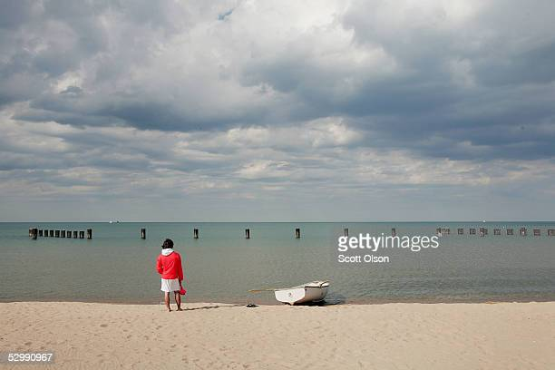 Lifeguard Ben Ingvoldscad watches over the waters of Lake Michigan at North Avenue Beach May 27 2005 in Chicago Illinois Chicago opened its public...
