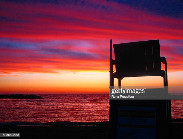 Lifeguard chair at sunset