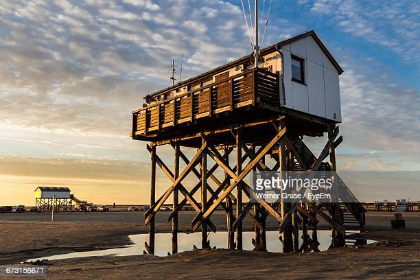 Lifeguard Hut At Beach Against Cloudy Sky During Sunset