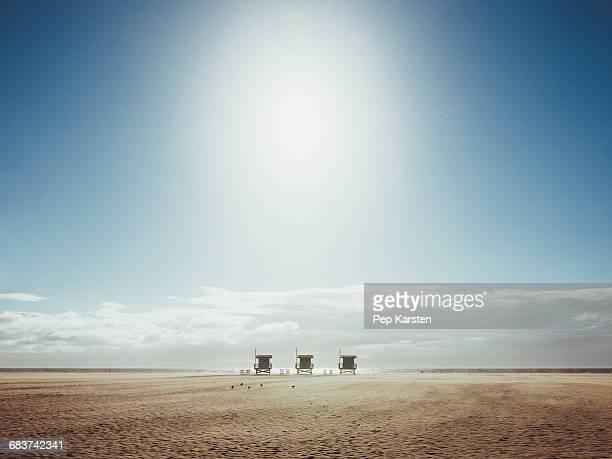 Lifeguard huts at beach against sky on sunny day, Venice Beach, Los Angeles, California, USA