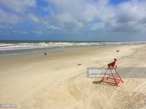 A lifeguard keeps watch over an almost deserted beach at Jacksonville Beach Florida USA on August 25 2014 The strong surf is a result of Tropical...
