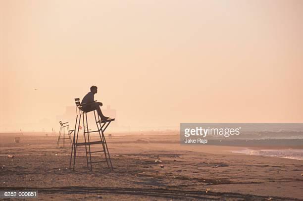 Lifeguard on Beach at Sunset