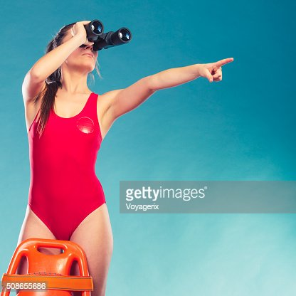 Lifeguard on duty with rescue buoy supervising. : Stock Photo