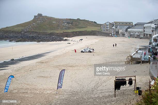 RNLI lifeguard patrols on a almost deserted Porthmeor Beach in St Ives on August 1 2016 in Cornwall England Many parts of the UK are experiencing wet...