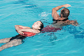 Lifeguard in training, rescuing victim from water