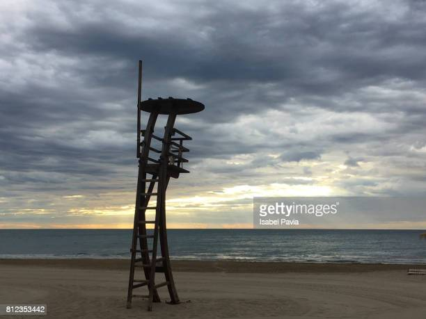 Lifeguard Seat At Beach Against Cloudy Sky at Sunrise