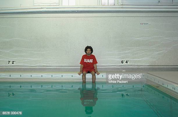 Lifeguard Sitting by Pool