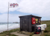 Lifeguard station at Gwithian Beach at the Godrevy Lighthouse end Cornwall UK