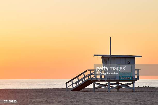 Lifeguard station at the empty beach during sunset