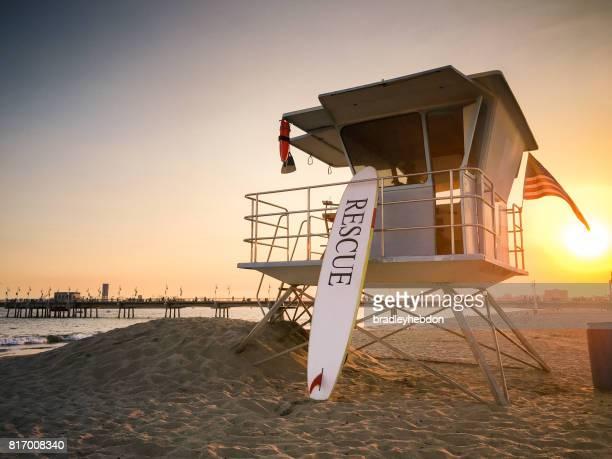 Lifeguard tower at sunset near pier in Long Beach, CA