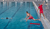 Lifeguard training course - rescuing victim from swimming pool