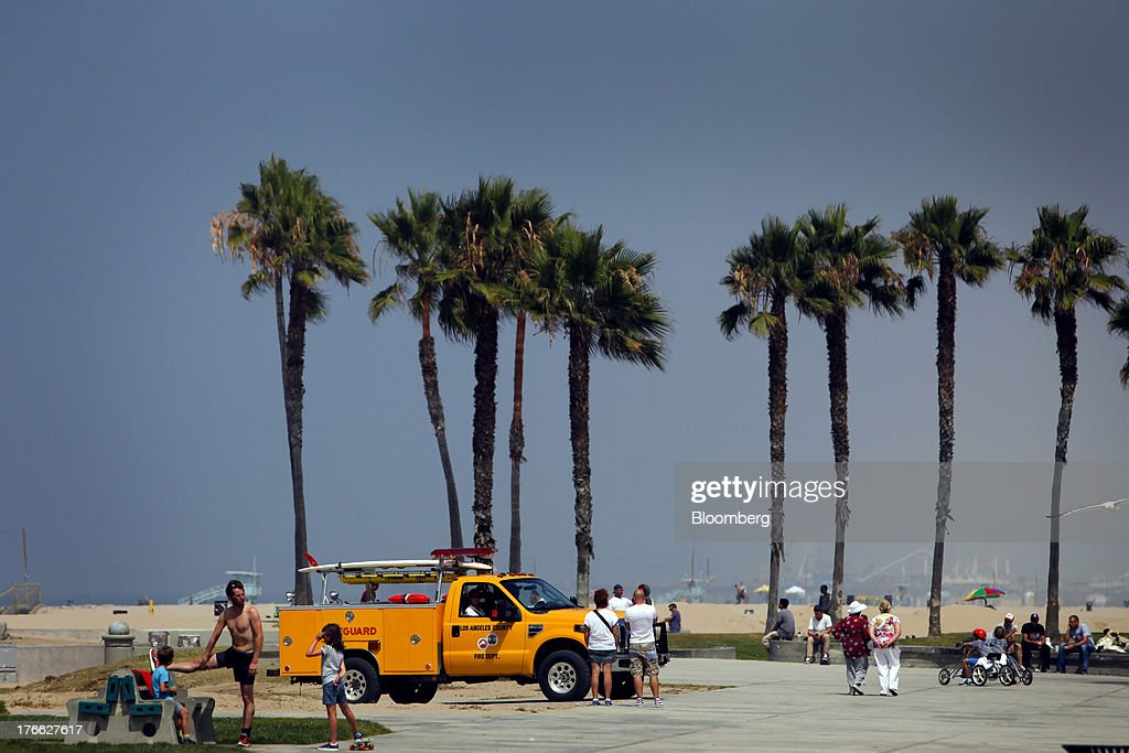 A lifeguard truck passes near palm trees at Venice Beach in Los Angeles, California, U.S., on Wednesday, Aug. 14, 2013. Overall U.S. tourism-related sales increased 6.8% in the second quarter of 2013 as compared to 2012. Photographer: Patrick T. Fallon/Bloomberg via Getty Images