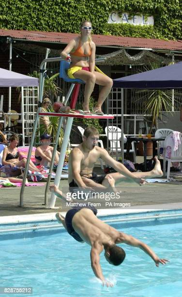 A lifeguard watches as 19yearold Nicky Henderson and 17yearold Frankie Cobban jump in the pool to cool off at Brockwell Park Lido in south London The...