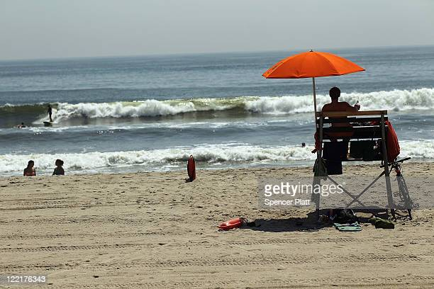 A lifeguard watches from his chair at a beach before the arrival of Hurricane Irene August 26 2011 in the Rockaways section of the Queens borough of...